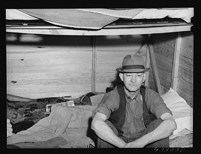 Four men live in this small shack. Two sleep on the lower cot and two on the upper. The whole shack is made so that it can be loaded onto a truck, has no floor all. At present the men work at Fort Bragg, North Carolina. Near Fayetteville, North Carolina