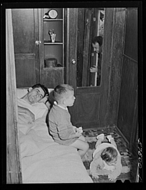 Frank Robbins of Wareham, Massachusetts, employed at United Aircraft, East Hartford, Connecticut, lives in trailer near the plant, with wife and four children because of housing shortage. He works nights, so he can sleep days in a bed used at night by two of the children. He makes forty dollars a week, his trailer payment is twenty dollars per month and twelve dollars rent for the campsite