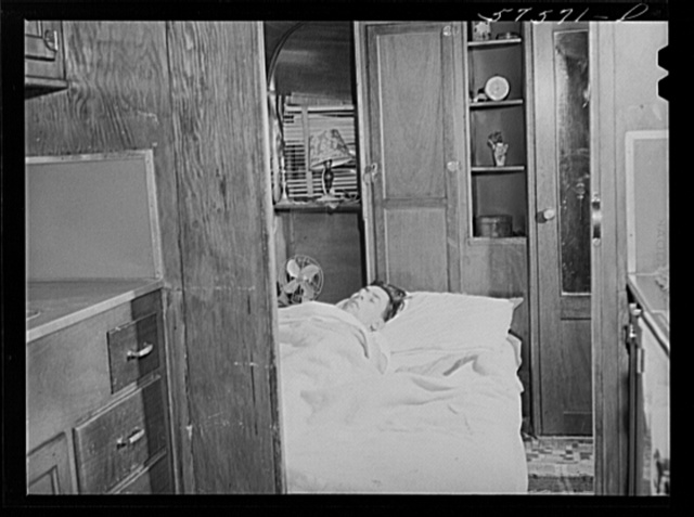 Frank Robbins of Wareham, Massachusetts, employed at United Aircraft, East Hartford, Connecticut, lives in trailer near plant, with wife and four children because of housing shortage. He works nights, so he can sleep days in a bed used at night by the children. He makes forty dollars a week, his trailer payment is twenty dollars per month, and twelve dollars rent for the campsite