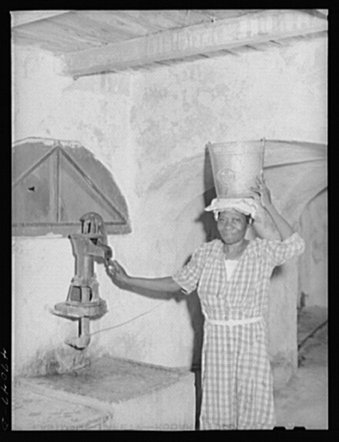 Frederiksted, Saint Croix Island, Virgin Islands. Drinking water at the Frederiksted hospital must be carried from this pump up to the kitchen on the third floor to be boiled