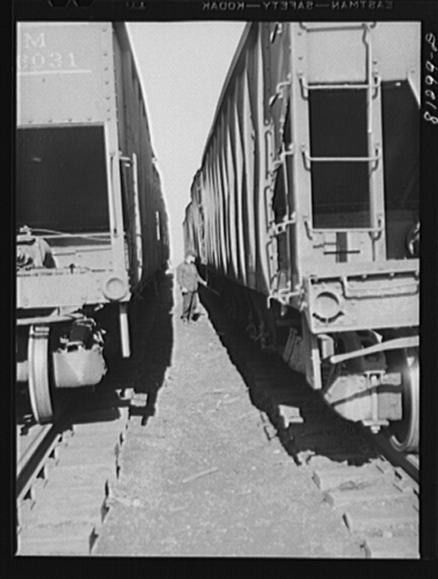 Freight cars loaded with coal waiting at dockside. Oswego, New York
