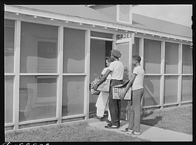 "FSA (Farm Security Administration) ""Food for Defense"" chickens being delivered to the Southeastern Air Training Center, Craig Field, Selma, Alabama"