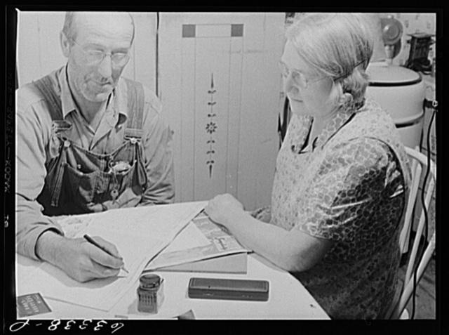 FSA (Farm Security Administration) rehabilitation borrower and wife working over account book. Itasca County, Minnesota