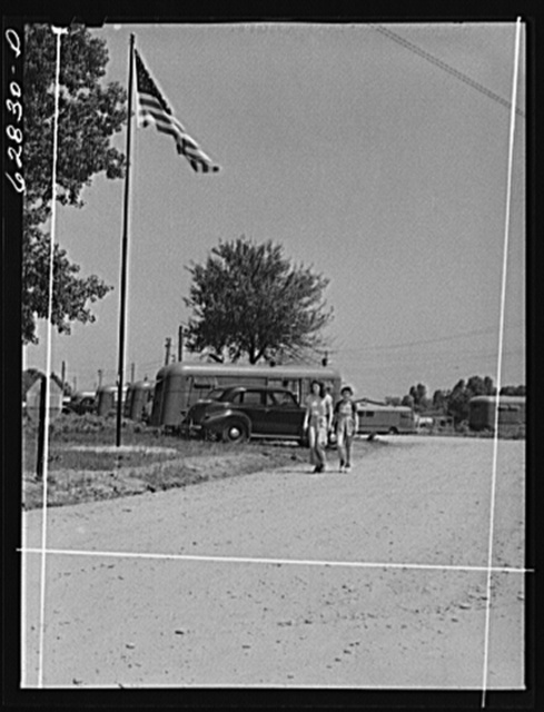 FSA (Farm Security Administration) trailer camp for defense workers, Erie, Pennsylvania. Flag and flagpole were donated by the General Electric plant