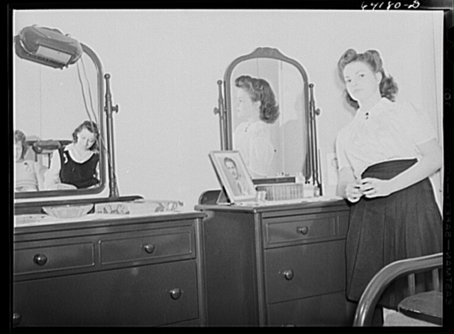 Girls who work at Aberdeen proving grounds and share a room in FSA (Farm Security Administration) dormitory for defense workers. Aberdeen, Maryland