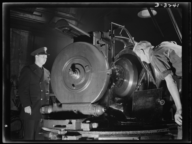 Good men, good machines, good materials mean good gears for the rear axles of halftrac scout cars now being produced for our Army in an Ohio truck plant. White Motor Company, Cleveland, Ohio