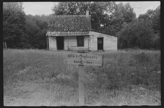 Government property sign at an abandoned house in the area taken over by the army for a maneuver ground. Caroline County, Virginia