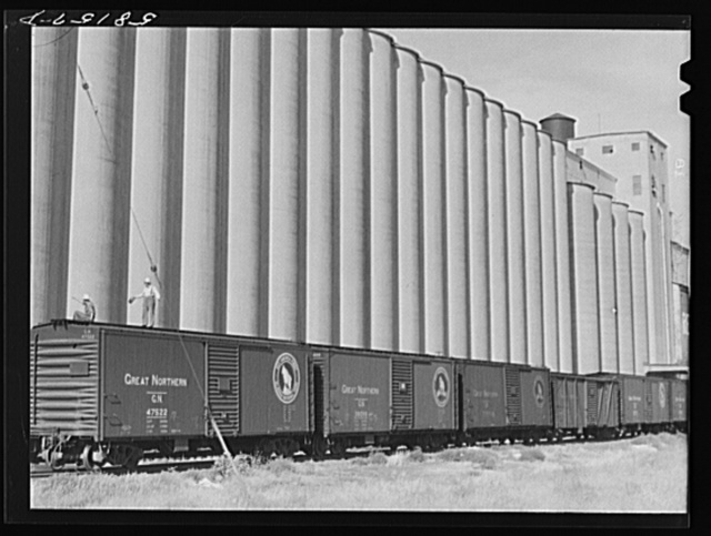 Grain storage, elevators and freight trains. Great Falls, Montana