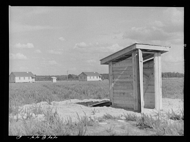 Group of prefabricated houses and privies that have been built by the FSA (Farm Security Administration) to take care of some of the white farmers who had to move out of the area taken over by the Army for maneuver grounds. Milford, Caroline County, Virginia