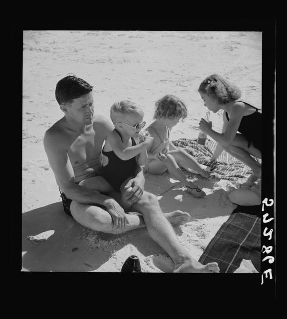 Guest of Sarasota trailer park, Sarasota, Florida, with his family, picnicking at the beach