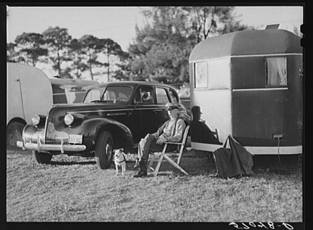 Guest of Sarasota trailer park sitting outside his trailer home. Sarasota, Florida