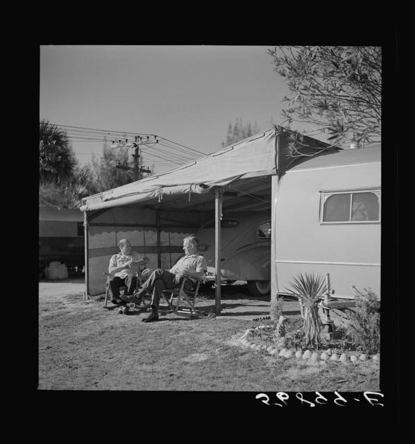 Guests at the Sarasota trailer park outside their trailer homes. Sarasota, Florida