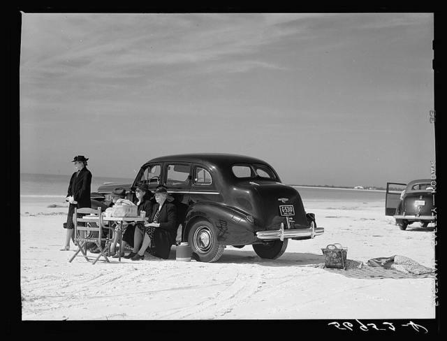 Guests of Sarasota trailer park, Sarasota, Florida, picnicking at the beach