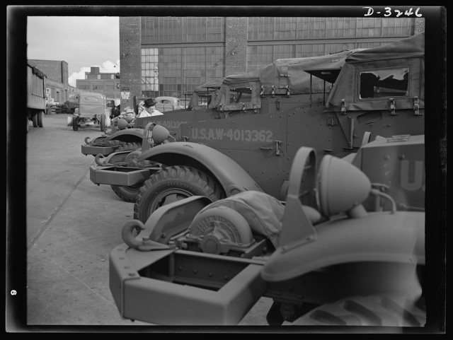 Halftrac scout cars ready for the Army except for the addition of certain pieces of Army equipment. The cars as they stand in the yard of a Midwest manufacturer are ready for combat duty. White Motor Company, Cleveland, Ohio