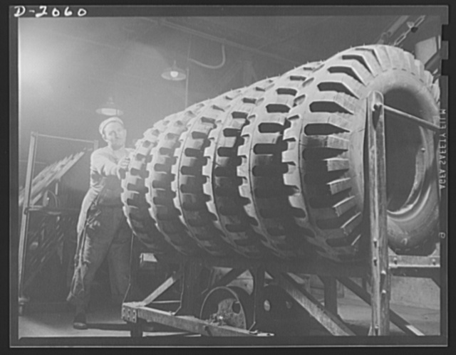 Headed for last cleanup. Six giant truck tires, of the non-directional type are being wheeled in for cleaning and painting. This pattern, developed for the U.S. Army in 1941 is used for field equipment....gives excellent traction in forward or reverse because of the horizontal cleats, yet rides well on the highway on the continuous center rib. Firestone (General) Tires, Akron, Ohio