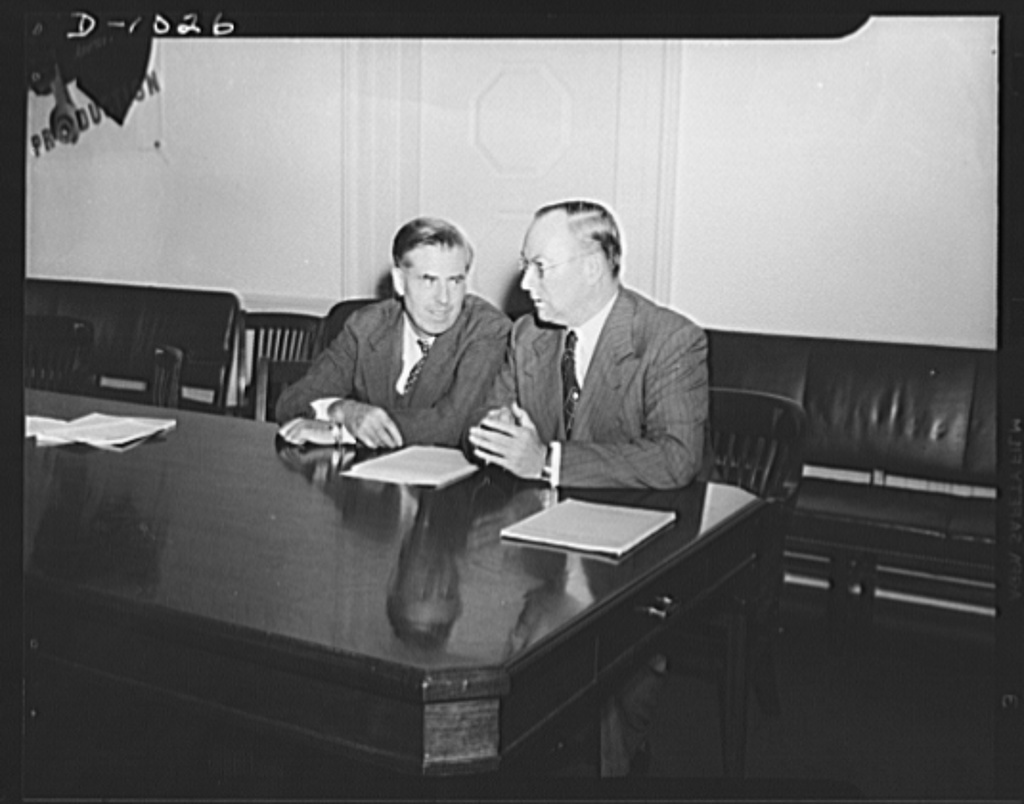 Henry A. Wallace, Chairman, Supply Priorities and Allocations Board and Vice-President of the United States, and Donald M. Nelson, Executive Director, Supply Priorities and Allocations Board and Director of the Priorities Division, Office of Production Management (OPM). Photograph taken at a joint press conference held directly after the first meeting of the Supply Priorities and Allocations Board on September 2, 1941