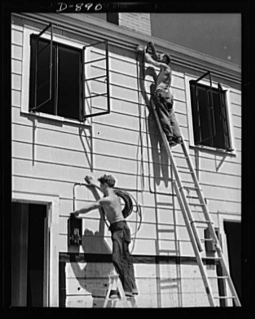Housing, Erie, Pennsylvania. Electrician wiring defense homes at the Franklin Terrace housing project. Homes are provided with electricity, sewage, police and fire protection. In many cases, a lump sum for all services is paid to the city in lieu of taxes