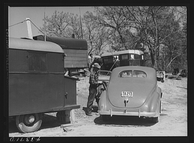 In a trailer settlement of workers from Fort Bragg. Manchester, North Carolina. The closest trailer is occupied by workers who came from Idaho