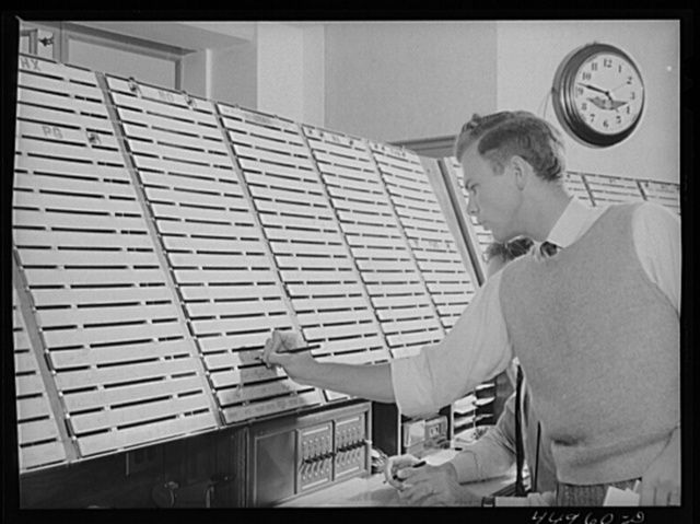 In the airport control room with which incoming and outgoing airliners are in constant communication. Flight data is kept on the white slips of cardboard. A new electrical control board just completed on the opposite side of the room will replace this one. Washington, D.C. municipal airport