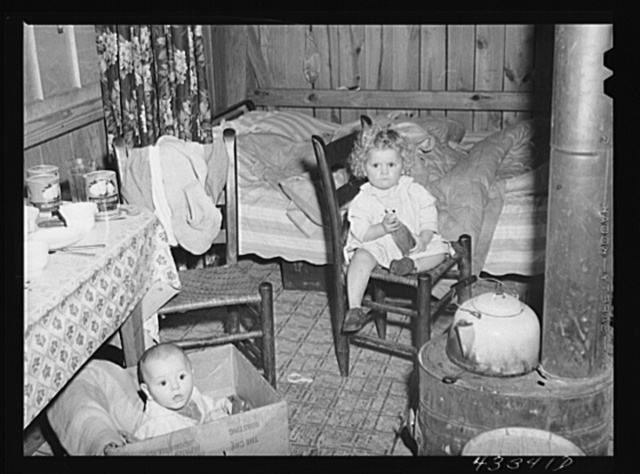 In the second story of a tobacco barn used as living quarters by family of workers from Fort Bragg, North Carolina. Near Fayetteville, North Carolina