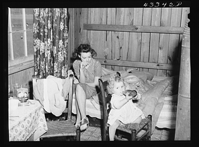In the second story of tobacco barn used as living quarters by family of workers from Fort Bragg, North Carolina, near Fayetteville, North Carolina