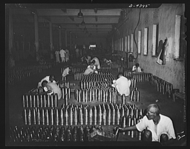 Indian industry by lend-lease. Finished show and shells are prepared for delivery from an Indian munitions factory. Skilled Indian workmen, using lend-lease machinery, have increased the shell production of this factory twenty-four times over a pre-war year