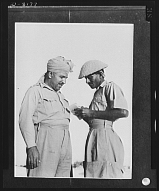 Indian troops in East Africa. Subadar Major gives his orders to the Orderly Sergeant