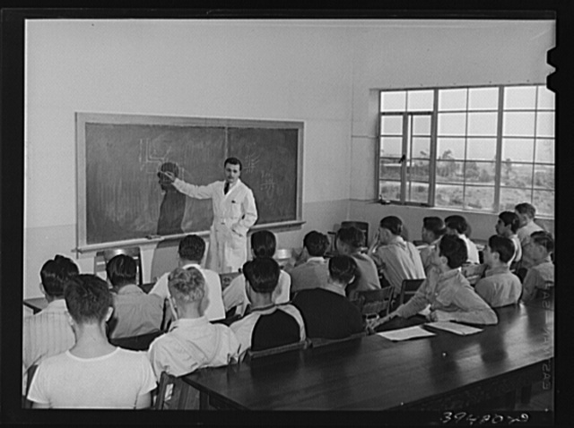 Instructor and class at the vocational school for aircraft construction workers. San Diego, California