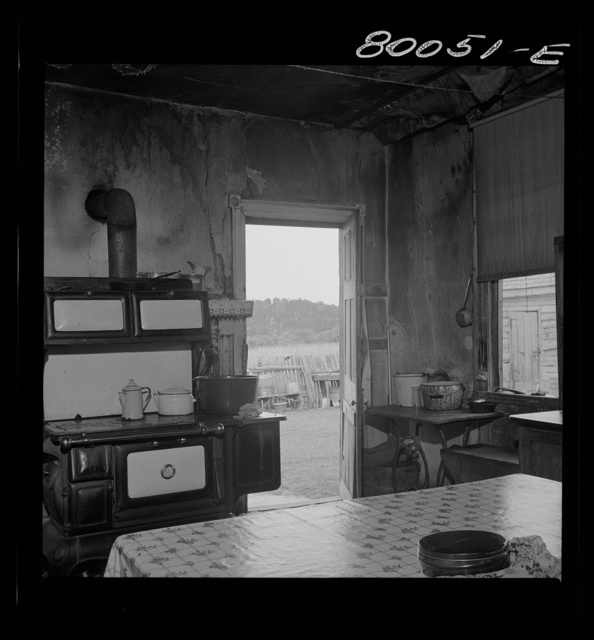 Interior of Biscoe kitchen. A fine stove, but no screens, and the plaster was falling off the walls. John Biscoe farmhouse, Ridge, Maryland. Saint Mary's County