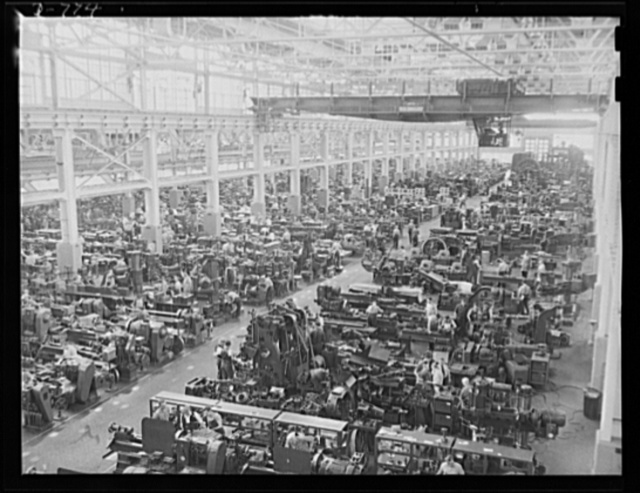 Interior of the tool and ie building, Ford River Rouge plant, Dearborn Michigan. Here radically new techniques of mass production have been developed and put in use. Machine tools and dies produced at this plant themselves make mass production easier and more rapid in other factories throughout the country. The building covers 8 1/2 acres; employs 4,500 skilled workers; equipped with 3 million dollars worth of machinery. Many machinists are being trained for the Navy, here by mechanics, tool and die makers