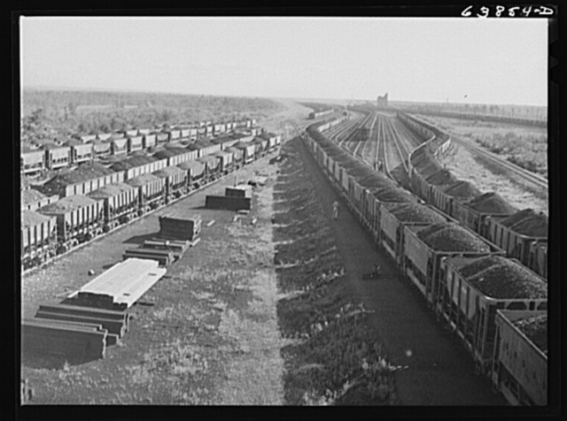 Iron ore from the Minnesota range in Great Northern Railroad yards at Superior, Wisconsin