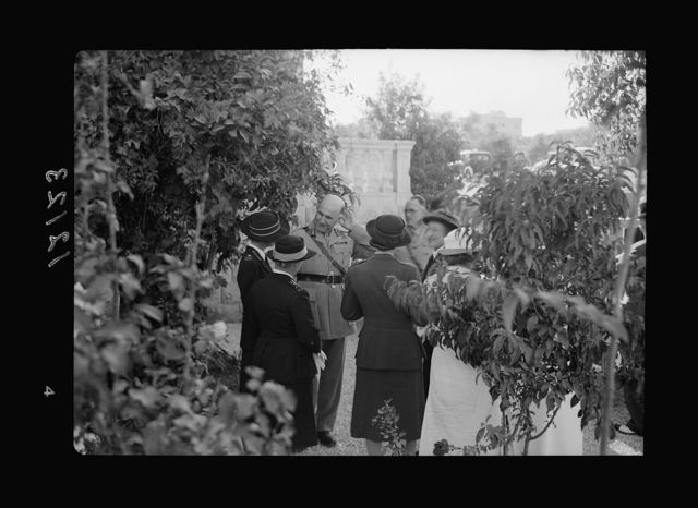 Lady McMichael [i.e., MacMichael] House (Knights of St. John, Br. [i.e., British] Red Cross, convalescent house for officers). Garden party, General Wilson talking to nurses