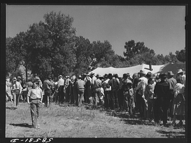 Line of guests waiting to get some barbecued beef at stockmens picnic. Spears Siding, Wyola, Wyoming