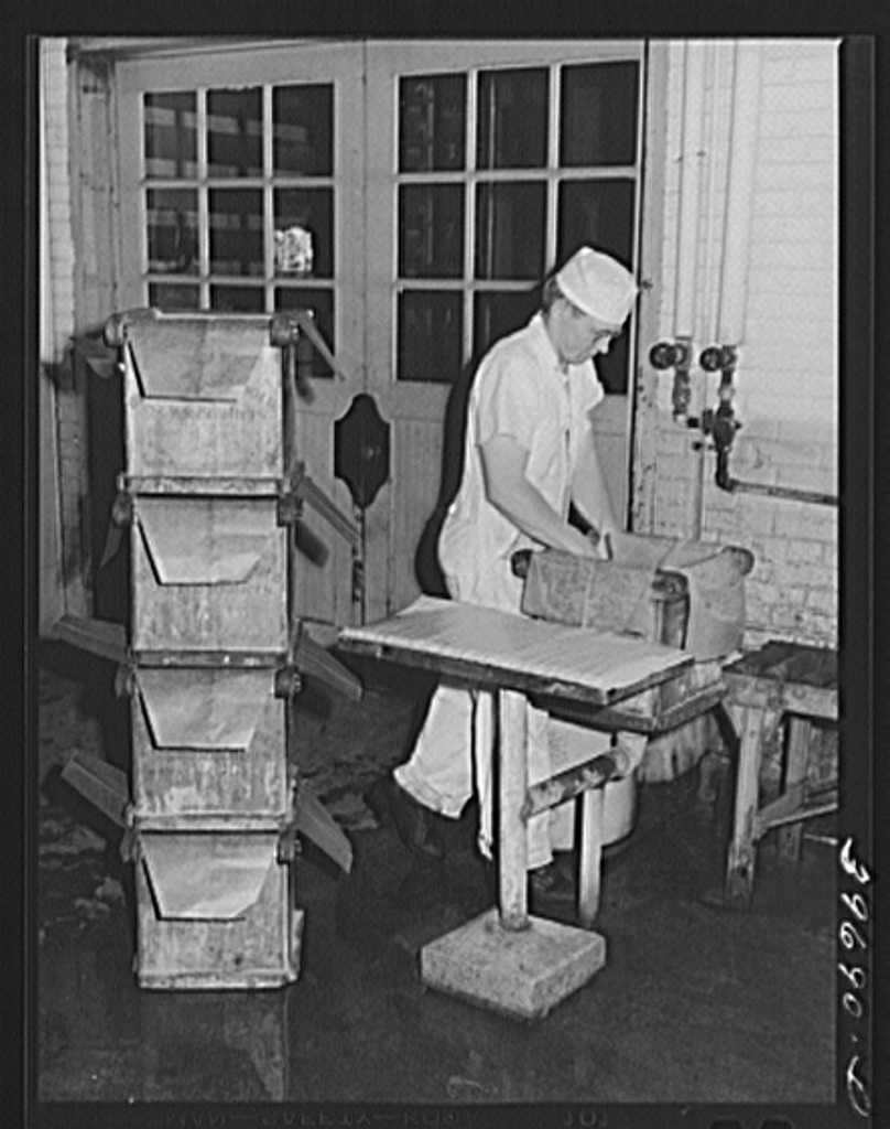 Lining tub with oiled paper before packing butter into it. Dairymen's Cooperative Creamery. Caldwell, Canyon County, Idaho