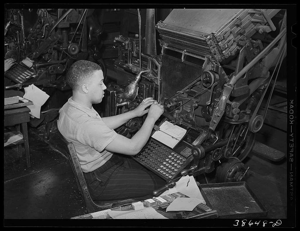 Linotype operator on the Chicago Defender, Negro newspaper. Chicago, Illinois