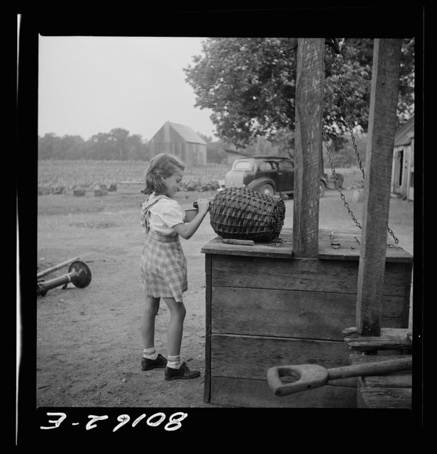 Little Miss Hardesty draws herself a drink. Charles County, Maryland