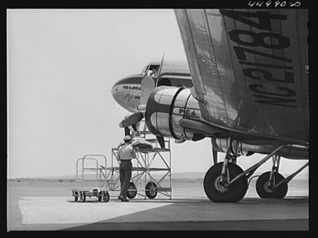 Loading baggage aboard an airliner. Washington D.C. municipal airport