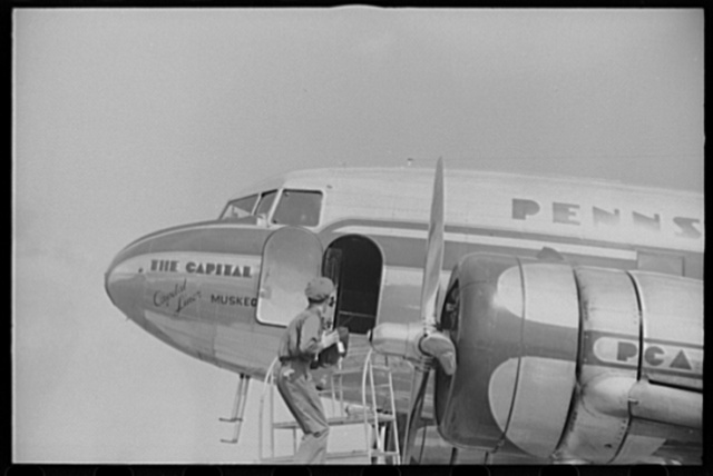 Loading baggage on a plane at the municipal airport in Washington, D.C.
