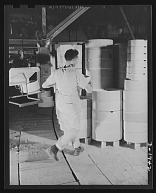 Loading saggers to take ware on tunnel kiln hearth. Shenango Pottery Works, Newcastle, Pennsylvania