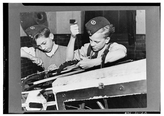 London (vicinity), England. Two members of the A.T.C. preparing to enter the Air Force working on an airframe