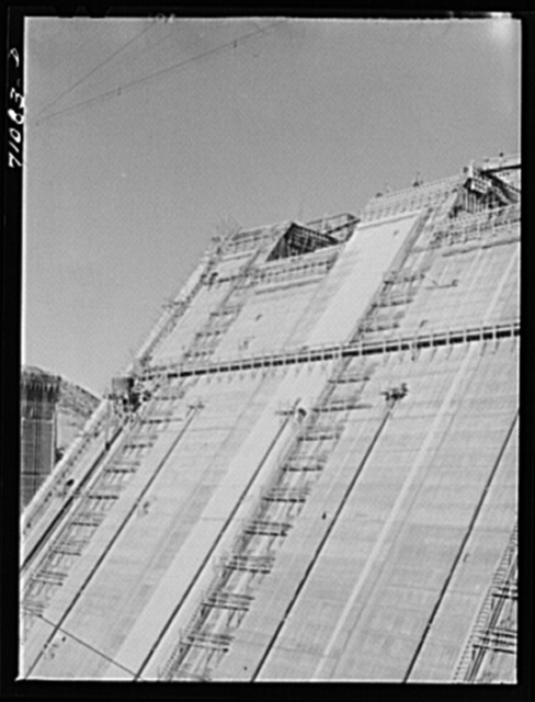 Looking up face of Shasta Dam, under construction. Shasta County, California