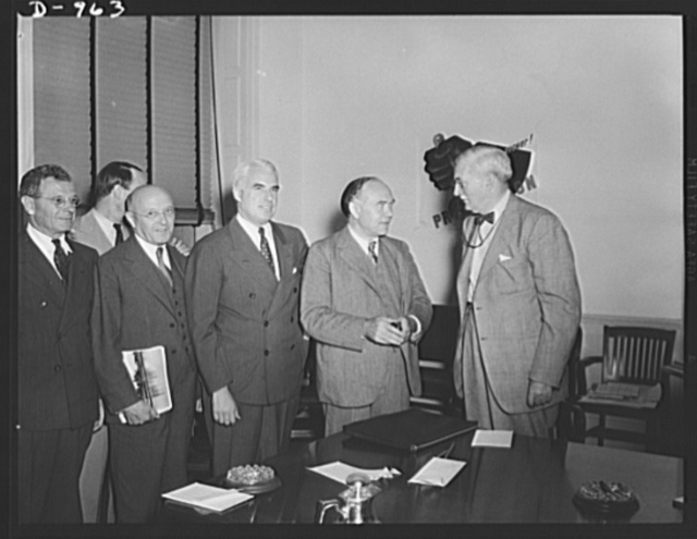 Lord Beaverbrook discusses British military and civilian needs with representatives of the Office of Production Management in Washington, D.C. August 19, 1941. Left to right: Sidney Hillman, Associate Director, OPM; John Lord O'Brian, General Counsel, OPM; Edward R. Stettinius, Jr. Director of Priorities, OPM; Lord Beaverbrook, British Minister of Supply; William S. Knudsen, Director-General, OPM