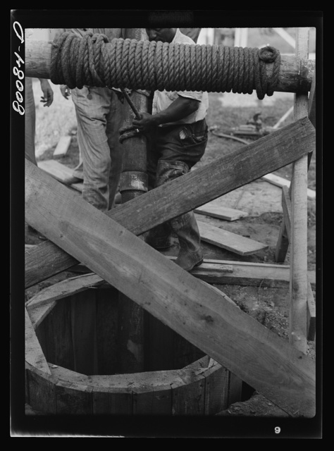 Lowering five foot steel casing into well. Safe well demonstration near La Plata, Maryland. Charles County