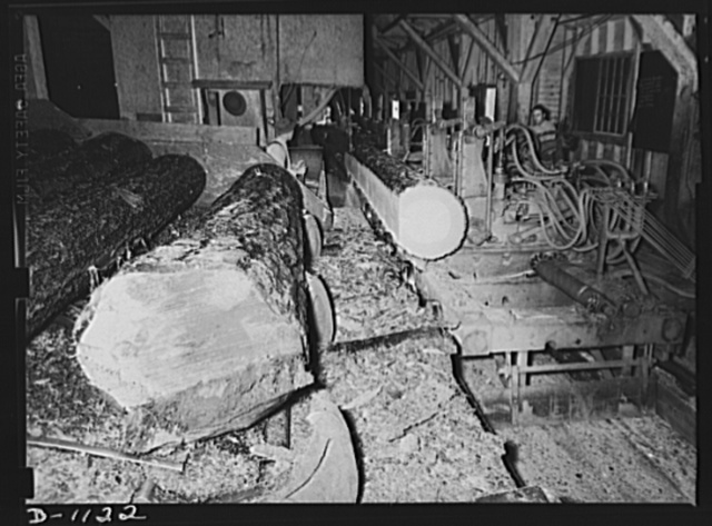 Lumber manufacture. Boise Payette Lumber Company, Boise, Idaho. On this hear rig (leg carriage) the logs are sliced down to Ponderosa pine boards, many of which are being used for defense construction