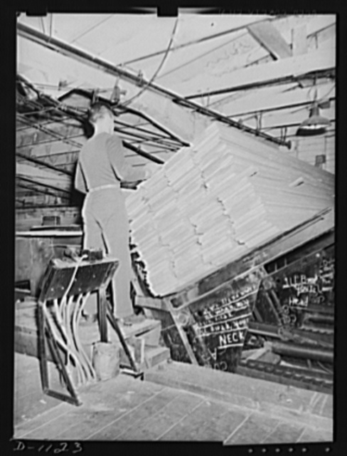 Lumber manufacture. Boise Payette Lumber Company, Boise, Idaho. Semi-finished boards on the automatic unloader which feeds then into the automatic planner for the finished operation