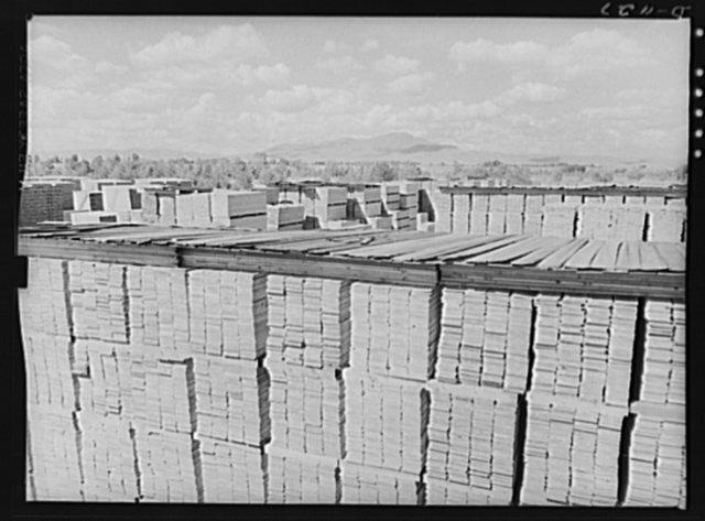 Lumber manufacture. Building stockpiles for national defense. Ponderosa pine boards being stacked at the Emmet, Idaho sawmills of the Boise Payette Lumber Company. Efforts are being made (June 1941) to create a stockpile of lumber to insure a steady monthly output of ammunition cases. Lumber is also supplied from these mills for the construction of barracks and cantonments