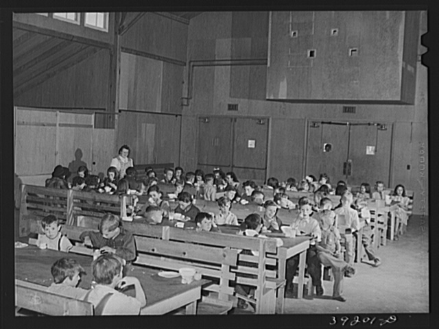 Lunchtime for schoolchildren at the community building of the FSA (Farm Security Administration) camp for farm workers. Caldwell, Idaho