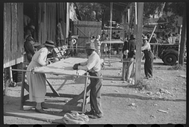 Making quilts from surplus commodity cotton in Greensboro, Greene County, Georgia