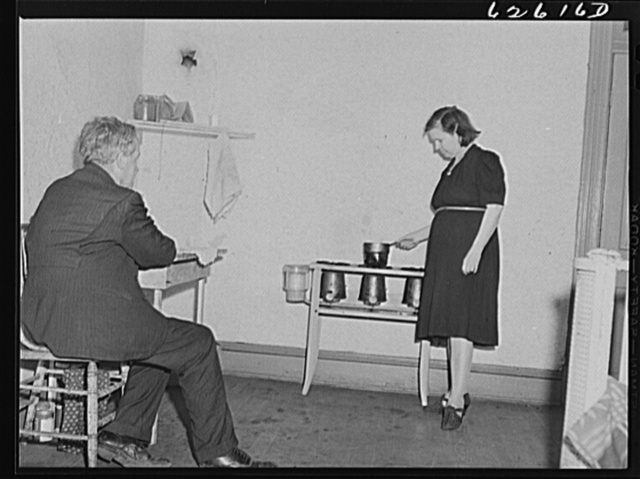 Man and wife from South Carolina. He just got a job in shipyards, moved into this one room apartment, rent eight dollars a week. Newport News, Virginia