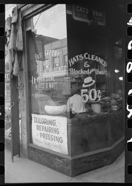 Many Negroes are employed in small enterprises such as this one on the South Side of Chicago, Illinois